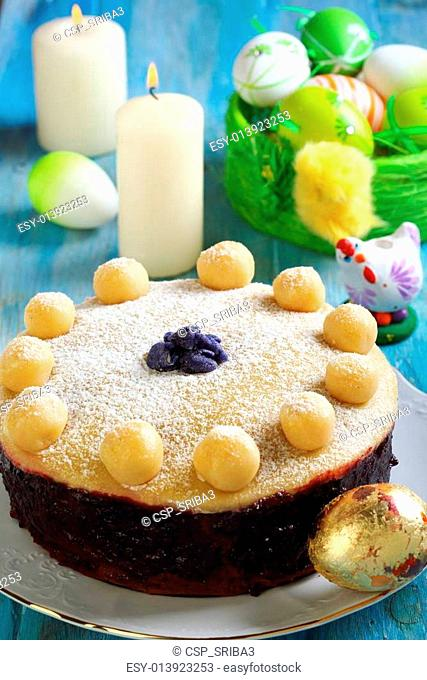 Easter cake and basket with colorful eggs