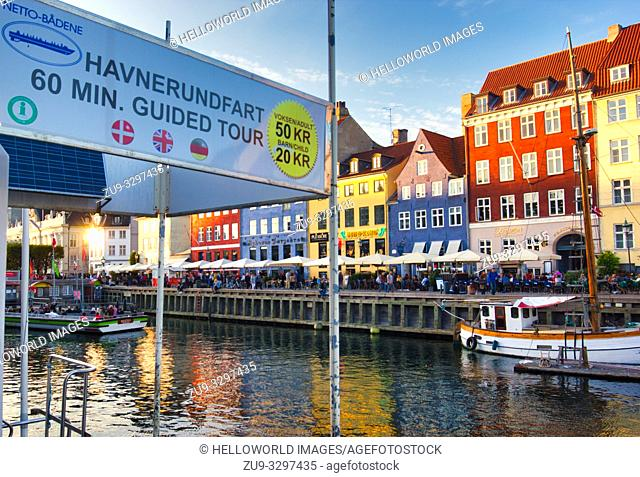 Guided boat tour prices, Nyhavn, Indre By, Copenhagen, Denmark, Scandinavia 17th century waterfront district lined by brightly coloured townhouses, cafes, bars