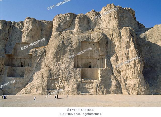 Naghshe Rostam near Persepolis. Achaemenian Tombs with visitors walking around