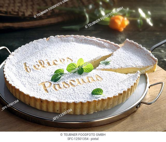Ostertorte Fluo - Ibiza y Formentera topped with goat's cheese and anise with icing sugar writting