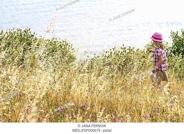 Greece, Corfu, Afionas, girl on a meadow