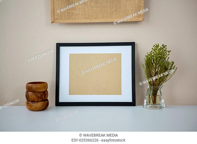 Picture frame with wooden pencil holder and vase