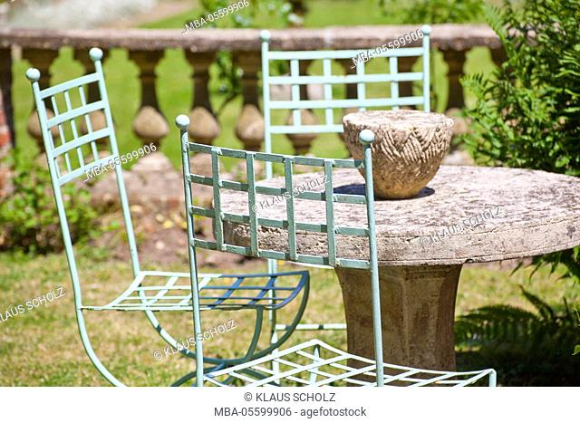 Metal chairs at stone table