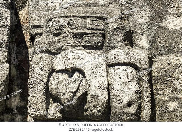 Carved reliefs on the summit staircase of Temple II, Temple of the Masks. Tikal, Guatemala, Central America