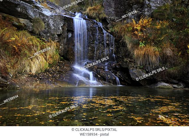 Small waterfall with a small pond with floating leaves in val Redorta, Val Verzasca, Sonogno, Canton Ticino, Switzerland