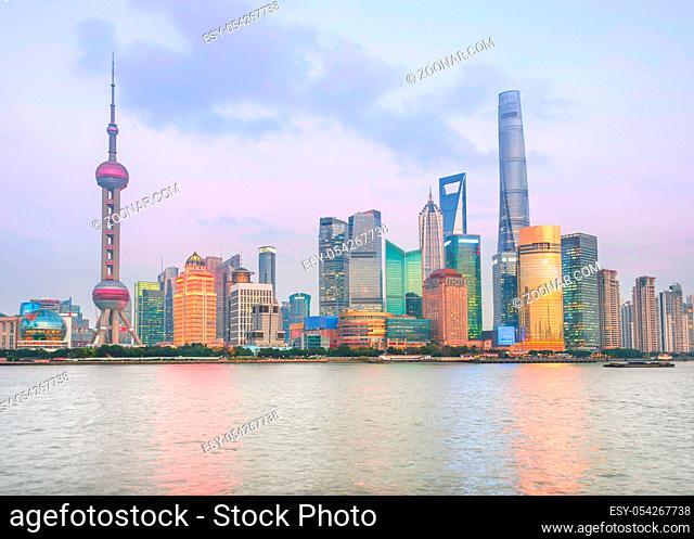 Illuminated Shanghai skyline at twilight, China