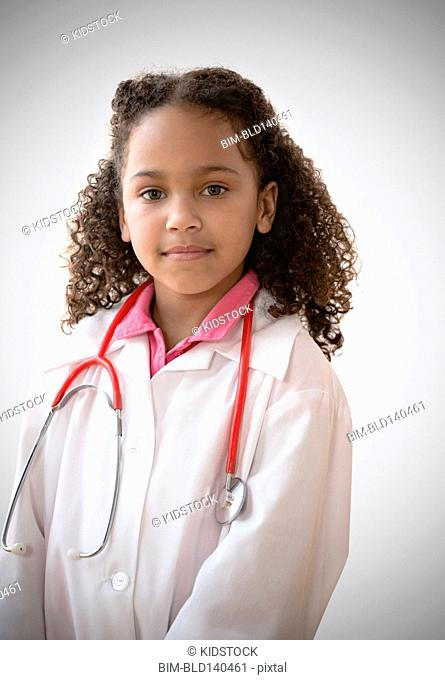 Mixed race girl playing doctor