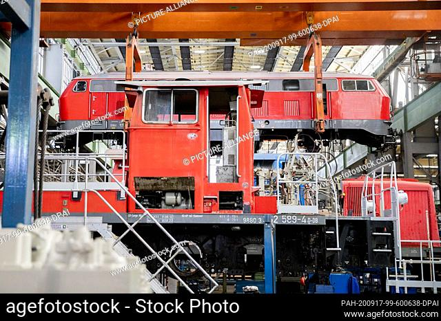 17 September 2020, Brandenburg, Cottbus: One locomotive (back) is hanging behind another on a crane when the development plans of Deutsche Bahn for the Lausitz...