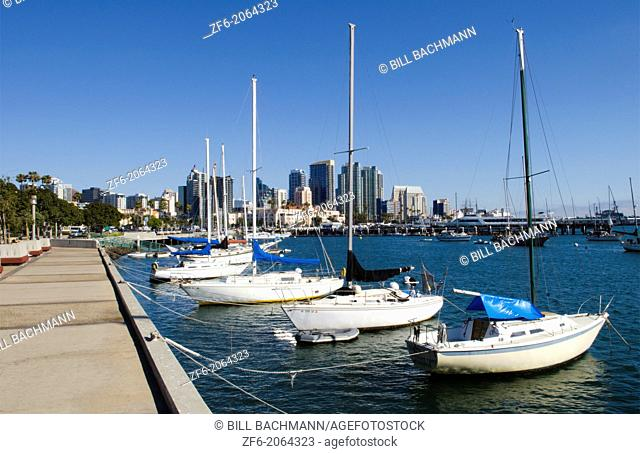City of San Diego skyline with boats at Harbor Island in California with sjyline of city in background
