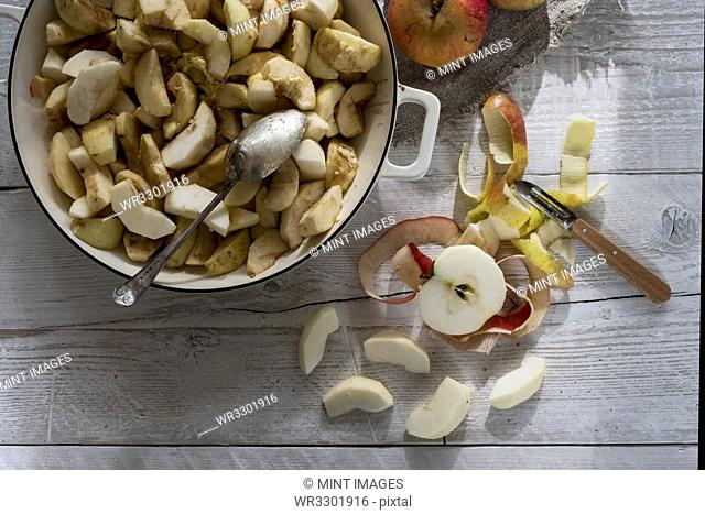 Close up of round baking tin with apple slices
