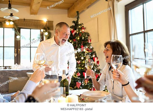 Happy senior man with family having Christmas dinner