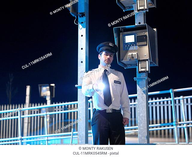 Security Guard At Gate With Torch