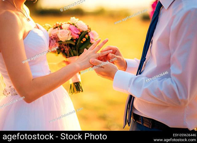 The newlyweds exchange rings at a wedding in Montenegro