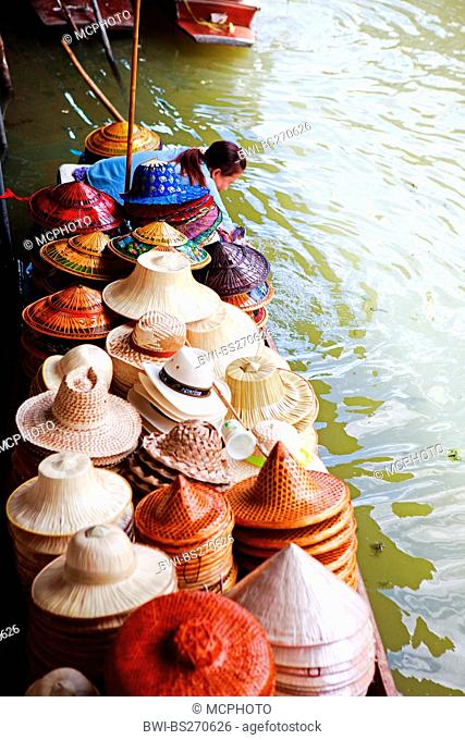 boat with hats at traditional Damnoen Saduak Floating Market , Thailand, Bangkok
