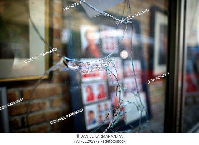 Cracks can be seen in the glass of a display window at the site of the attack in the courtyard of 'Eugen's Weinstube' in Ansbach, Germany, 26 July 2016