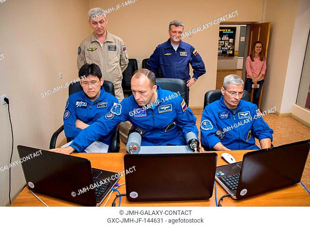 At the Cosmonaut Hotel crew quarters in Baikonur, Kazakhstan, Expedition 52-53 backup crewmembers Norishige Kanai of the Japan Aerospace Exploration Agency...