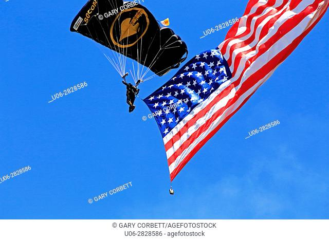 Skydiver and US flag in tow