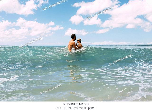Father with child in sea