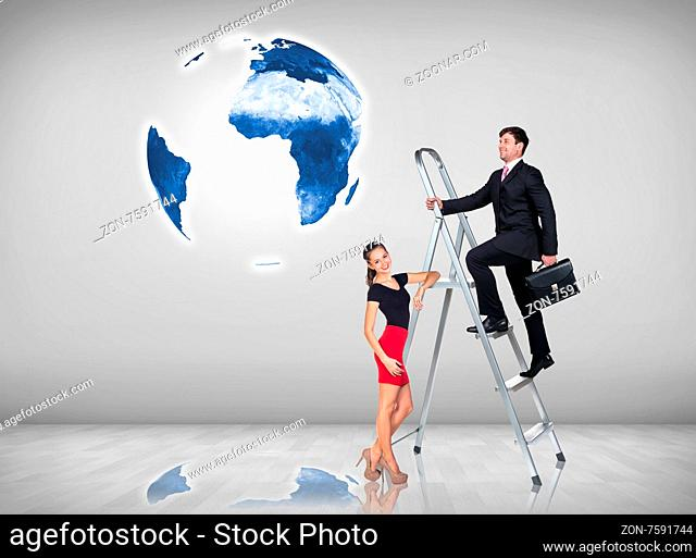 Businessman with woman assistant climbing a ladder with motivation background. Elements of this image furnished by NASA
