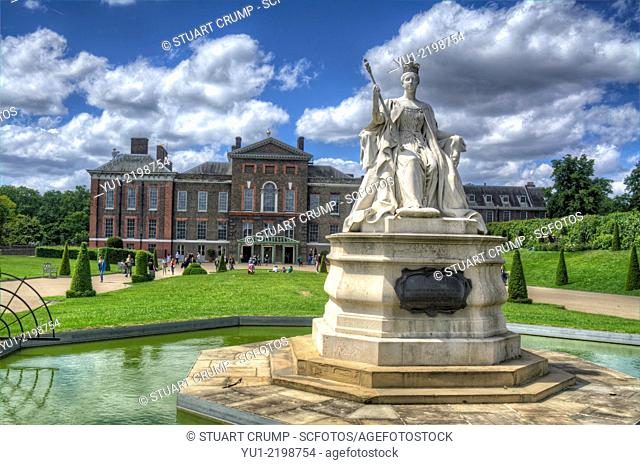 HDR image of A Statue of Queen Victoria outside of Kensington Palace a royal residence set in Kensington Gardens, in the Royal Borough of Kensington and Chelsea...