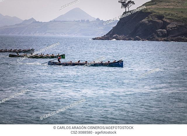 CASTRO URDIALES, SPAIN - JULY 15, 2018: Competition of boats, regata of trainera, Urdaibai Avia, Go Fit Hondarribia and Zierbena Bahias Bizkaia boats in action...