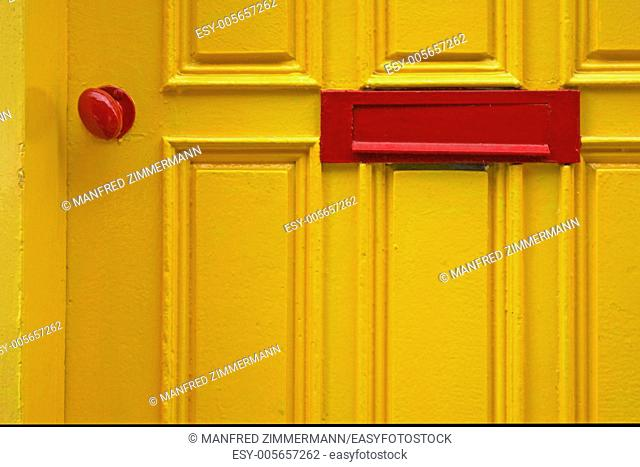 Extract of yellow with red door knob and letter drop,