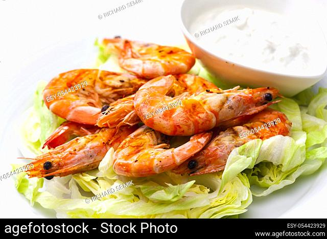 still lfe of grilled shrimps with garlic dip