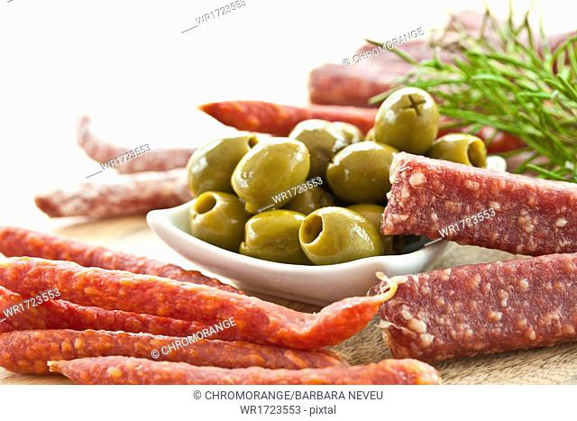 Sausages and green olives