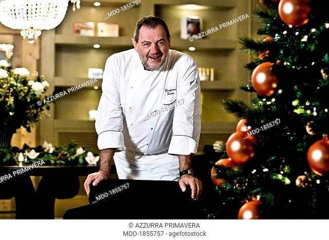 Italian chef Gianfranco Vissani smiling beside a Christmas tree for a photocall shooted at his restaurant. Terni (Italy), 29th November 2013