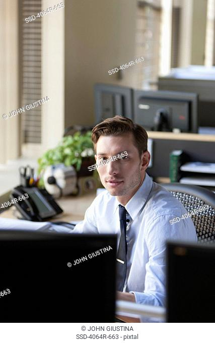 Businessman at his desk in office