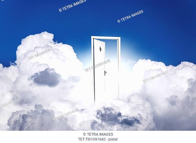 Opened door in clouds