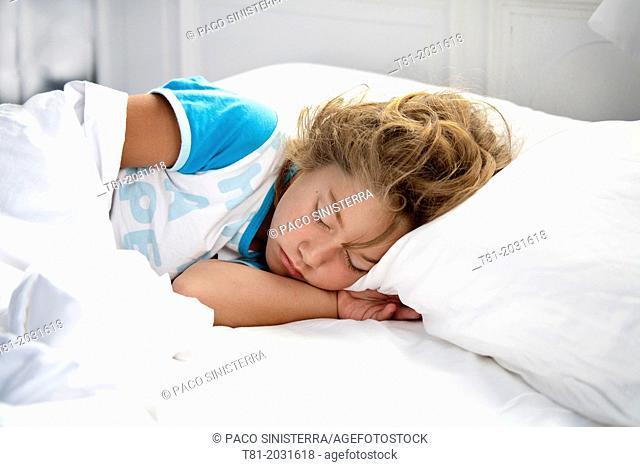 Sleeping girl, white sheets, face down, Ribadesella, Spain