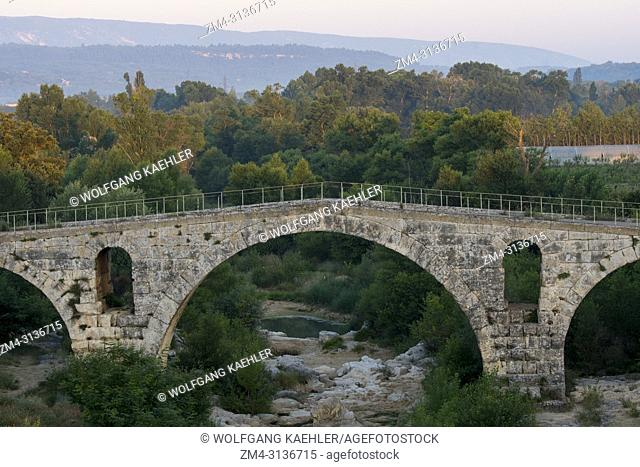 The Pont Julien is a Roman stone arch bridge over the Calavon River, in the Provence in southern France, dating from 3 BC