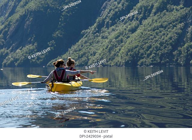 Kayaking in Gros Morne National Park; Trout River, Newfoundland, Canada