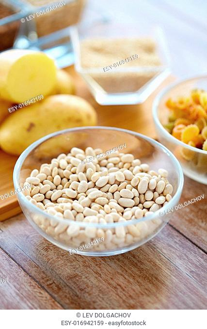 protein diet, cooking, culinary and food concept - close up of beans in glass bowl on table
