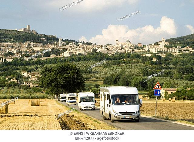 View of Assisi with mobile homes in the foreground, Umbria, Italy, Europe