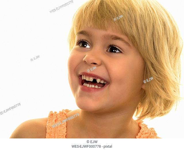 Portrait of smiling girl with tooth gap