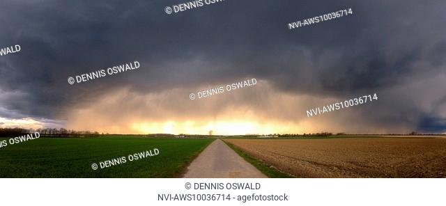 Snow pellet shower during sunset in March near Neuss, North Rhine-Westphalia, Germany