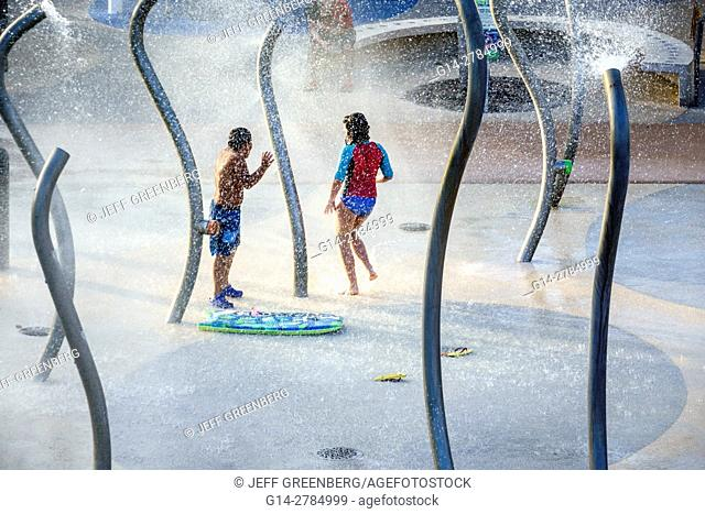 Florida, Miami Beach, South Pointe Park, splash pad fountain, boy, girl, playing