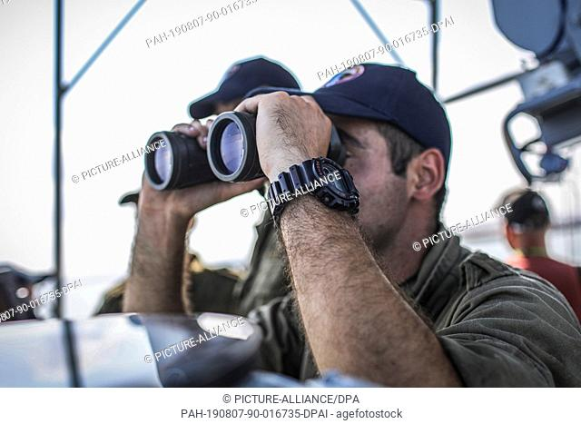 07 August 2019, Israel, Haifa: A soldier looks from a magnifying glasses during a multi military forces drill. Israeli Defence Forces in cooperation with US