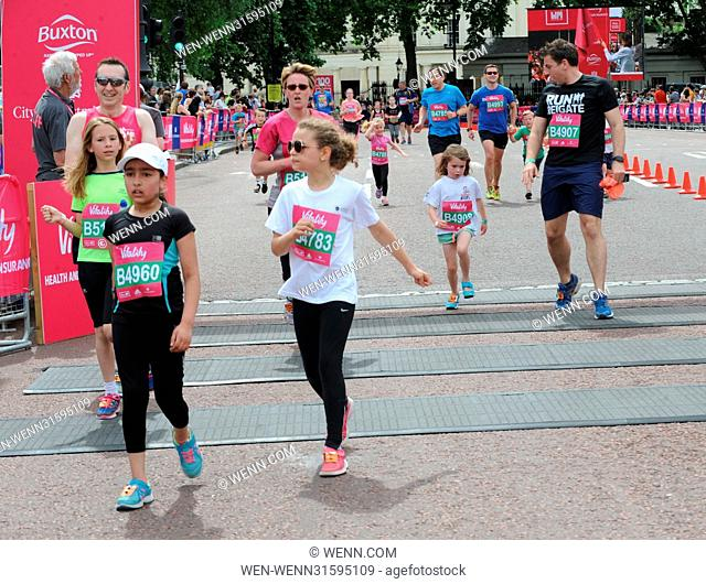 Runners of all ages cross the finish line at the Vitality Westminster Mile in front of Buckingham Palace Featuring: Atmosphere Where: London