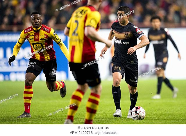Mechelen's William Togui and STVV's Santiago Colombatto fight for the ball during a soccer match between KV Mechelen and STVV Sint-Truiden