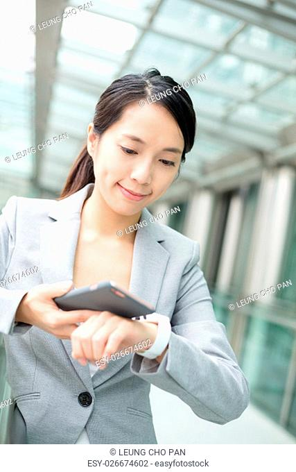 Business woman use of smart phone and watch