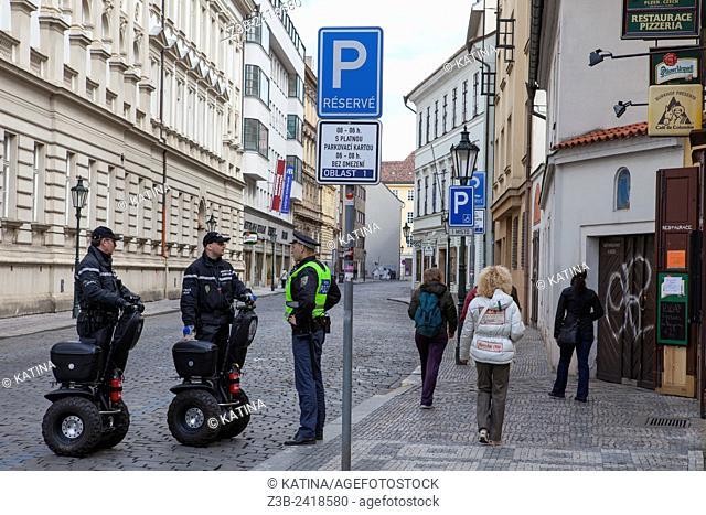 Police on segways having a conversation, Prague, Czech Republic, Europe
