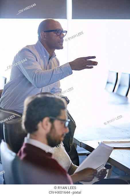 Businessman gesturing and explaining in meeting