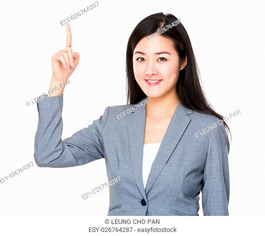 Businesswoman with finger showing up