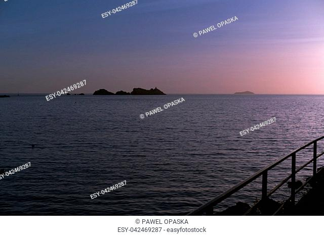 Sunset over the rocky Croatian coast in Dubrovnik, Croatia