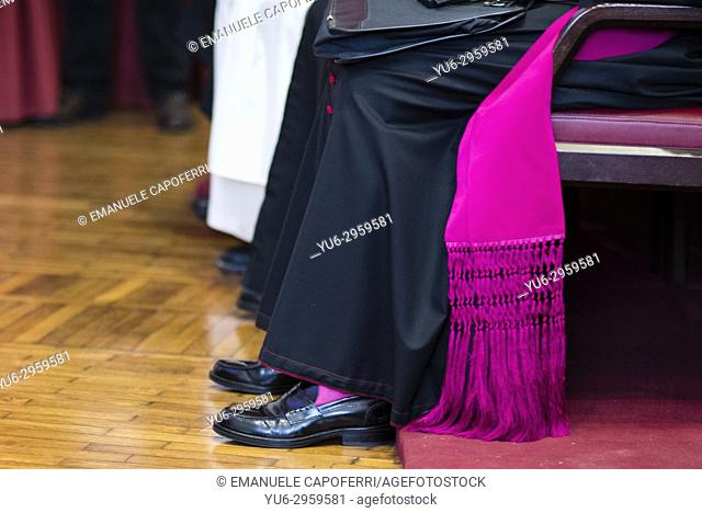 Bishop of the Catholic Church shoes and robe