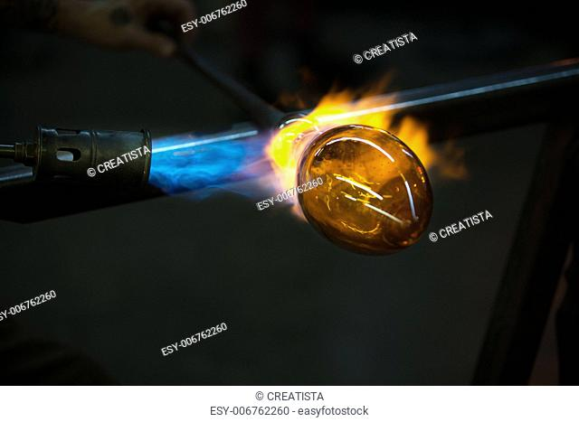Close up of flame from blowtorch on new glass art piece