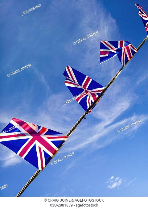 British Union Jack flags against a blue sky